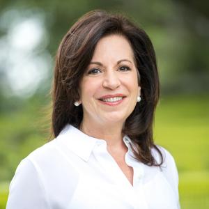Andi Berkman,                       Agent in Houston - Compass
