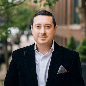 Tony Reyes,                       Agent in Chicago - Compass