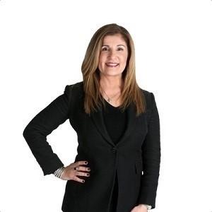 Carmela Lummis,                       Agent in Houston - Compass