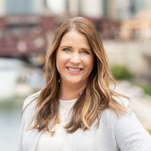 Barbara Domin,                       Agent in Chicago - Compass