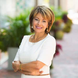 Carmen Fontecilla,                     Agent in DC - Compass