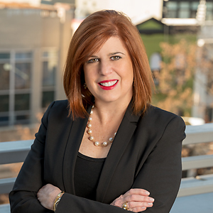 Claudia Kern,                       Agent in DC - Compass