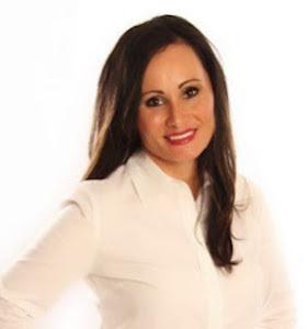 Elisa Snyder,                       Agent in Miami - Compass