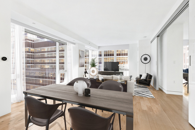 Experience the ultimate glamour and energy of New York City in this exclusive private address in the heart of Manhattan. This luxurious two bed, two bath, 1,124 square foot home is brand new and in triple mint condition. South East exposure and floor to ceiling windows flood the living room and master bedroom with natural light. The brilliantly appointed Molteni kitchen features Italian walnut and custom white back-painted glass cabinetry with bronze satin mirror, detailing Calacatta Vision polished marble countertops, Watermark fixtures and top of the line Miele appliances. Custom designed Rimadesio white back painted glass sliding walls separate the living room from the master suite, which features double closets and an en suite master bath outfitted with radiant heat Siberian White tile flooring, a custom white back painted glass vanity topped in Siberian Mink Stone with imported Italian Fantini fittings and fixtures. A utility closet with Miele washer and dryer brings an additional convenience to your home. The building offers a 12,000 square foot private residents' club featuring a suite of luxury services and amenities, such as a terrace, pool, gym, children's playroom, and roof deck, providing the ideal urban retreat. A 24-hour doorman and concierge ensure that the finest of New York City's cultural and gastronomic delights are at your fingertips and that every convenience is attended to with ease.