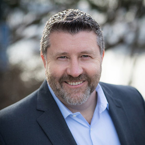 Mark Petrak,                     Agent in Seattle - Compass