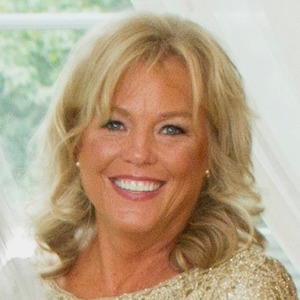 Maureen Barone,                     Agent in Chicago - Compass