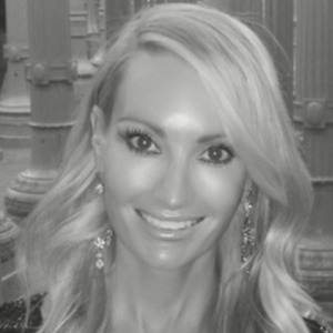 Dana Grigalunas,                       Agent in Chicago - Compass