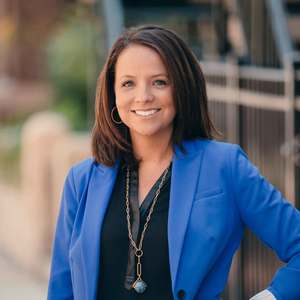 Margot Lavin,                     Agent in Chicago - Compass