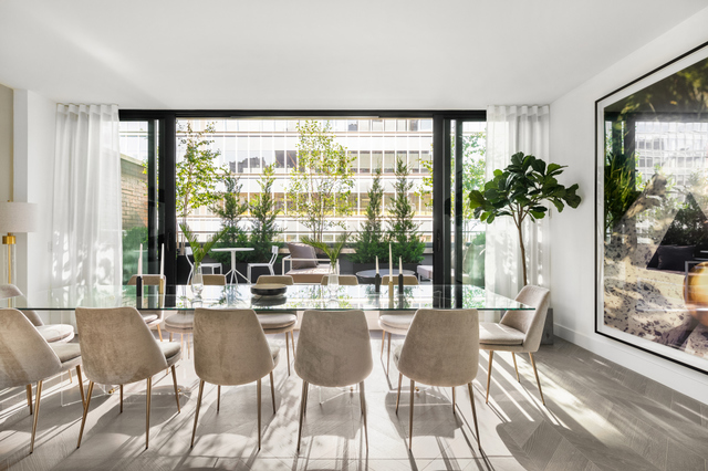 "Located in a peaceful oasis of TriBeCa, this brand new five-bedroom home offers 4,176 square feet of interior space and three private terraces. Designed by acclaimed architect Morris Adjmi, this unrivalled penthouse showcases interiors customized by Stefano Pasqualetti. Described as ""soothing and timeless"" when featured in DEZEEN magazine, the rich finish palette references the iconic window frames of the building's facade.   Arrive via keyed elevator to each of the four floors where the stage is set for bright and airy living spaces ideal for both lavish entertaining and serene everyday living.    On the lowest level are three bedrooms, all complete with ensuite bathrooms. The bright and spacious west-facing master suite is privately tucked away in its own wing, offering two large walk-in closets and a sumptuous master bath. Exquisite finishes of the five-piece bath include radiant heated lava stone floors, Carrara bamboo marble walls, integrated Pietra Serena double sink with walnut vanity by GD Cucine, standup shower, and separate deep-soaking tub.   Upstairs, the second level features a living room of grand proportions plus two more bedrooms and full bathrooms. The great room encompasses almost five hundred square feet of entertainment space facing west with floor-to-ceiling windows.    On the third level, the beautifully equipped open Chef's kitchen stands ready to accommodate lively dinner parties or quiet family meals. Designed by GD Cucine, finishes include Italian Maroon Marinace marble countertops and backsplash, satin glass and walnut cabinetry, Wolf gas oven range with vented hood, Wolf steam oven, Wolf drawer microwave, Miele dishwasher, and a 46 bottle SubZero wine refrigerator. On the opposite end of the floor, an expansive dining area fuses with the lush private outdoor space to create the perfect indoor/outdoor entertainment atmosphere. Also located on this level is a powder room.   The top floor offers a fifth bedroom or den area, a full bathroom, and two additional private terraces. The east-facing views offers extraordinary unobstructed views to the south of the Freedom Tower, and the west-facing terrace offers unobstructed views to the north.    This townhouse in the sky is flanked with a sculptural staircase in blackened steel, marble and oak, and features seven-inch wide plank Italian oak floors in a ""dark sand"" hue, central air conditioning, and a vented professional series Maytag washer & dryer.   403 Greenwich is a brand new boutique condominium positioned on a coveted TriBeCa block between Beach and Hubert Streets. The exclusive new development is comprised of just three duplexes and one Penthouse, promoting an intimate environment. Amenities include a private keyed elevator and virtual doorman."
