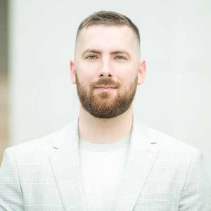 Tim Grimes,                       Agent in Houston - Compass