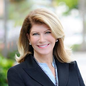 Karen Bellows,                       Agent in Miami - Compass