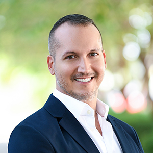 Hector Valdes,                     Agent in Miami - Compass