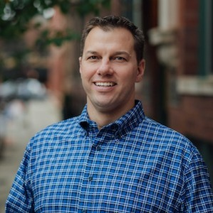 Mike Tarjan,                       Agent in Chicago - Compass