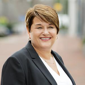 Teresa Mueller,                       Agent in DC - Compass