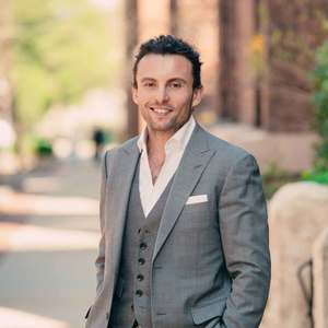 Damian Kosydar,                     Agent in Chicago - Compass