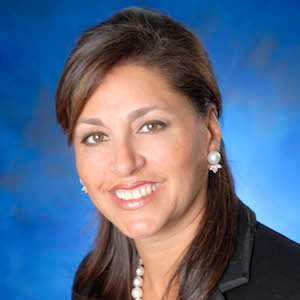 Azita Aghravi,                       Agent in NYC - Compass