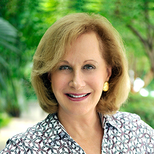Janet Tralins,                       Agent in Miami - Compass