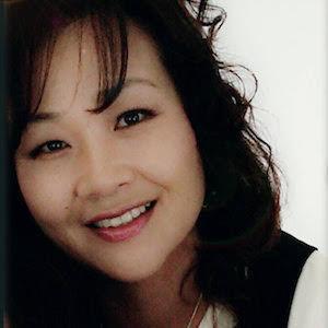 Headshot of Song Kim