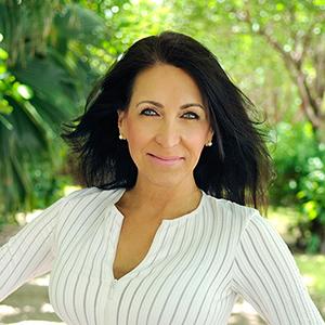 Lynn Buchanan,                     Agent in Miami - Compass
