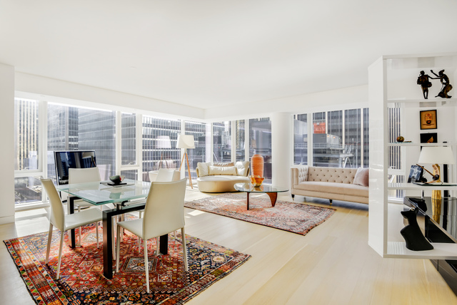 Stunning 1,432 square foot, 2-bedroom, 2-bathroom condominium home with all the amenities of modern luxury – the perfect retreat in the heart of Midtown Manhattan. Completed in 2016, Unit 23C at 135 West 52nd Street offers an expansive open-plan living space and striking city views, coupled with luxurious design and finishes throughout, including rift-sawn 5-inch white oak plank flooring. From the entry foyer, which includes a spacious double-door coat closet, a gallery leads into the corner Great Room where floor to ceiling windows showcase exceptional south- and east-facing views of the city. For seamless living and entertaining, the living area melds with the open chef's kitchen, which features Italian walnut and custom white back-painted glass cabinetry, Calacatta Vision polished marble countertops, Watermark fixtures, and premier appliances by Miele. The luxurious Master Suite is filled with light from a wall of south-facing floor to ceiling windows, and affords ample space for any wardrobe with multiple deep closets. The ensuite master bath, accessed through custom Rimadesio white glass pocket doors, has radiant-heated Siberian White marble flooring, a custom vanity topped with Siberian Mink stone, imported Italian Fantini fittings and fixtures, a soaking tub, and separate walk-in shower. The second bedroom is generously proportioned, with south-facing exposures and beautiful natural light. A second full bathroom and in-unit Miele washer and dryer complete this well-appointed home. 135 West 52nd Street offers residents unparalleled amenities, including a 12,000 SqFt Private Residents Club, 75-Foot Indoor Swimming Pool, State-of-the-Art Fitness Center, Luxurious Spa, Children's Playroom, Golf Simulator, Furnished Outdoor Terrace, Media Screening Room, Live-In Resident Manager, and Full-Time Doorman and Concierge Services. Located in the heart of Midtown Manhattan, 135 West 52nd Street is steps from Central Park, Fifth Avenue, Rockefeller Center, Times Square, C