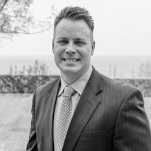 Christian Schoenenberger,                     Agent in Chicago - Compass