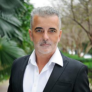 Patrice Hallot,                       Agent in Miami - Compass