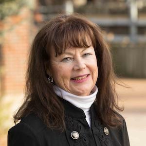 Cheryl Mitrick,                     Agent in Chicago - Compass