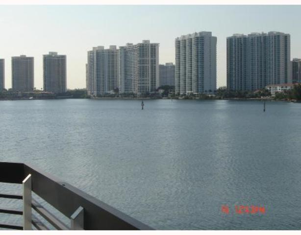 3530 Mystic Pointe Drive, Unit 201 Image #1