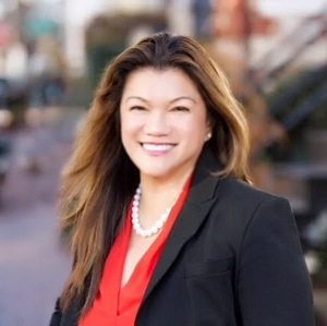 Cristina Sison,                     Agent in DC - Compass
