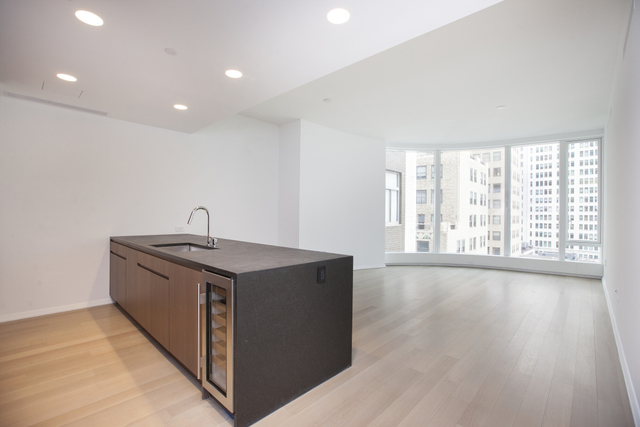 Enjoy the light and serenity of this beautiful and brand new 2 bedroom 2 and a half bath home at 50 West Street.50 West is a 64 story brand new residential tower featuring floor to ceiling curved glass windows and impressive 4 floors of amazing amenities, including an immense Fitness Center, the beautifully-appointed Water Club, unique children's amenities, and The Observatory, the outdoor entertaining space on the 64th floor with outstanding views of NYC and beyond. This masterpiece was created by internationally acclaimed architect Helmut Jahn and designed by Thomas Juul-Hansen.10A is an eastern facing 2 bedroom 2 and a half bath apartment with top notch finishes and appliances. The kitchen features custom stained walnut cabinetry, granite countertops and waterfall island and is equipped with two Miele wall mounted convection ovens, gas cooktop, dishwasher and range hood that vents to the outside. The chef's kitchen is beautifully complimented by a Sub-Zero refrigerator, freezer and wine refrigerator.With plenty of closet space and in-unit washer/dryer, this gorgeous 2 bedroom is complete with state of the art marble bathrooms and vanities. The en-suite five fixture master bath features a floating, backlit marble vanity, radiant floor heating, Hansgrohe polished chrome fixtures, an electronic Toto toilet with built-in bidet, a stall shower and a separate deep soaking tub. The second bath and powder room both include marble wet walls and flooring as well as custom vanities.This one of a kind apartment will be sure to impress, with endless amenities and perks, including partial broker fee paid by the owner. Don't miss out on this stunning opportunity!