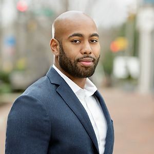 Evan Marbury,                     Agent in DC - Compass