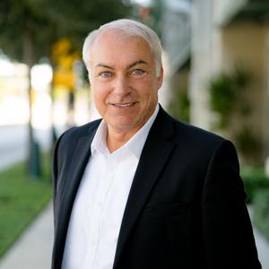 Martin Schaefer,                       Agent in Miami - Compass