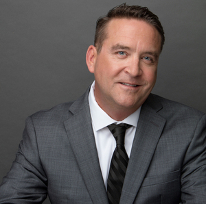 John Snyder,                     Agent in Los Angeles - Compass