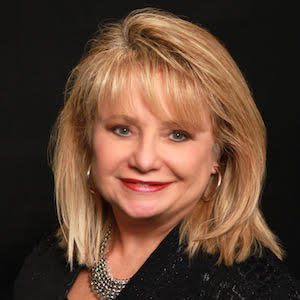 Carol Best,                     Agent in Chicago - Compass