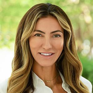 Neila Rudden,                       Agent in Miami - Compass