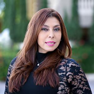 Liz Miller,                     Agent in Miami - Compass