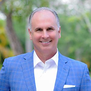 Chuck Luciano,                       Agent in Miami - Compass