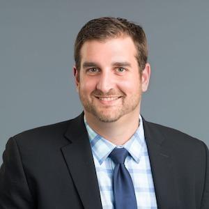 Tom Carioscio,                       Agent in Chicago - Compass