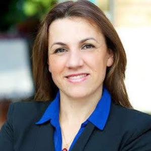 Khadija Laurens,                       Agent in Chicago - Compass