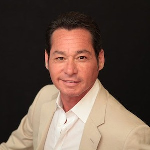 Mitch Serrano,                     Agent in Chicago - Compass