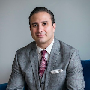 Michael Mandile,                     Agent in Chicago - Compass