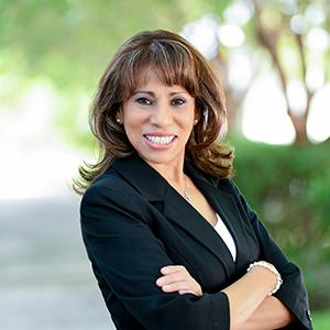 Martha Dominguez,                       Agent in Miami - Compass