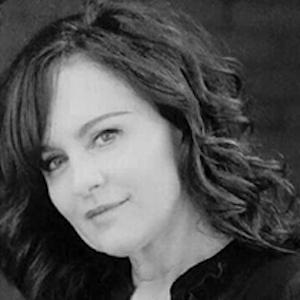 Rita McGlothlin,                     Agent in Chicago - Compass