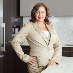 Rosa Martinez,                     Agent in Chicago - Compass