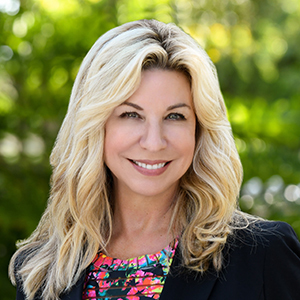 Kim Penton,                       Agent in Miami - Compass
